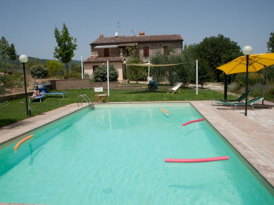 View of the holiday house with pool