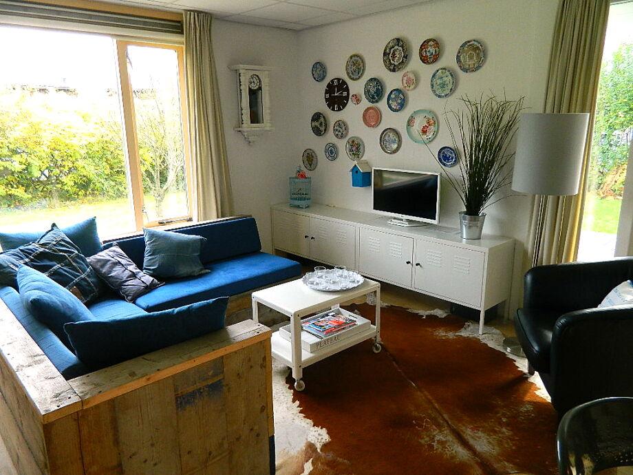 Das Wohnzimmer mit gemütlicher Sitzecke
