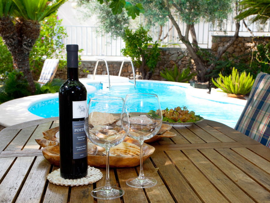 Enjoy wine by the pool
