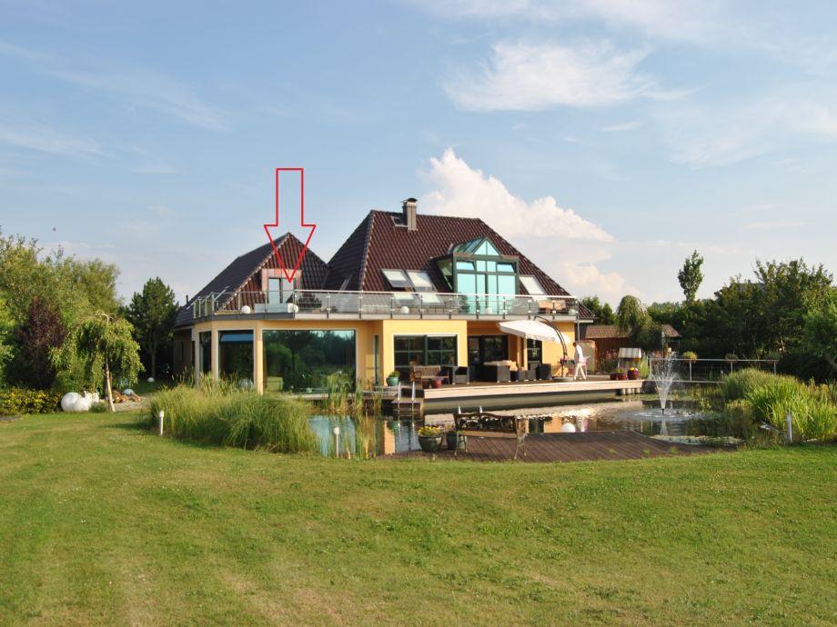 Ferienhaus und Parklandschaft
