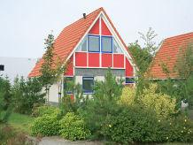 Ferienhaus mit Boot im Villapark Schildmeer
