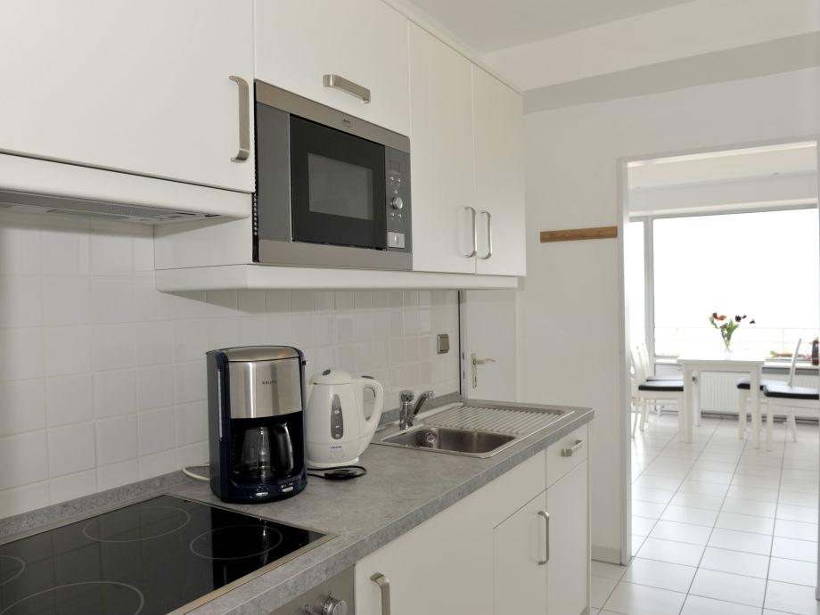 Komplett ausgestattete küche der suite neue und modere schlafzimmer