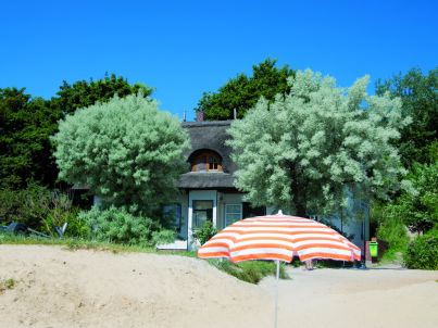 Holiday apartment in a thatched house by the beach.