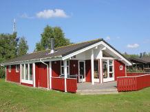 Rot-weißes Spitze Ferienhaus
