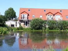 Ferienwohnung Happy im Haus am Teich