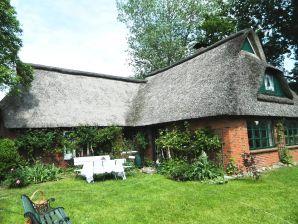 Cottage Wildgarten mit Reetdach